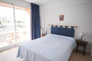 Кровать или кровати в номере Apartamentos Concorde