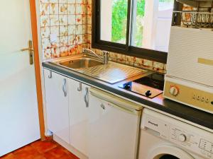 A kitchen or kitchenette at Holiday Home Marines d'Agosta-3