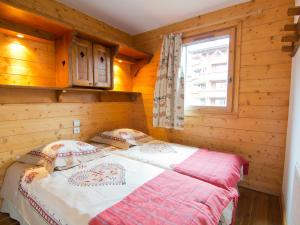 A bed or beds in a room at Apartment Les Alpages de Reberty