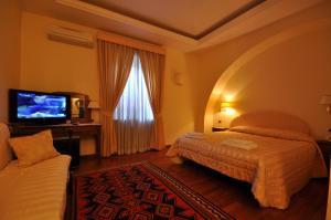 Letto o letti in una camera di Casale De Santis