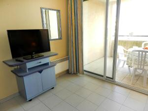 A television and/or entertainment center at Apartment Les Marines