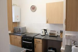 A kitchen or kitchenette at Anson Apartment