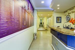 The lobby or reception area at Hotel Erechim