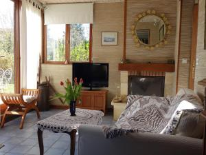 The lounge or bar area at Holiday Home La Tour