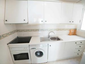 A kitchen or kitchenette at Apartment Edificio Mediterranea II