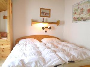 Ein Bett oder Betten in einem Zimmer der Unterkunft Holiday Home Altes Land.2