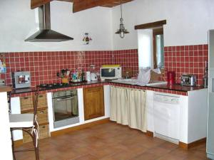 A kitchen or kitchenette at Holiday Home La Grèze