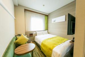 Tempat tidur dalam kamar di Hotel Sardonyx Ueno