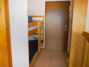 A bunk bed or bunk beds in a room at Apartment Le Bochate-4