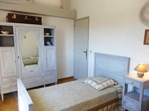 A bed or beds in a room at Holiday Home Les Iris