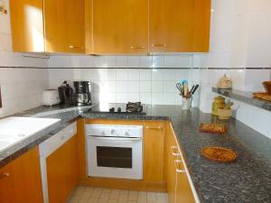 A kitchen or kitchenette at Holiday Home Les Arpèges-2