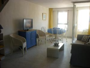 A television and/or entertainment center at Apartment Agde Marine I-3