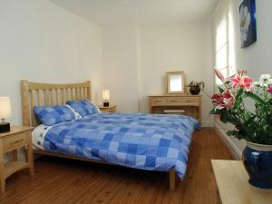 A bed or beds in a room at Holiday Home Ballyhass Lakes-1