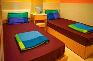 A bed or beds in a room at Fuji Hostel