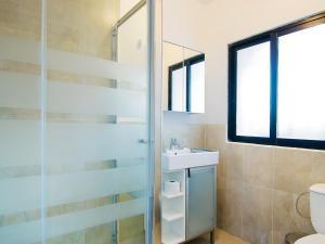 Ett badrum på Villa Villa Noelia