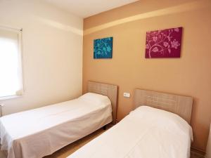 Cama o camas de una habitación en Holiday Home Vilafortuny