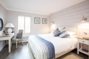 A bed or beds in a room at Master Builder's House Hotel
