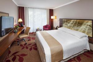 Ein Bett oder Betten in einem Zimmer der Unterkunft Hotel Ascot