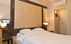 A bed or beds in a room at Hotel Plasky