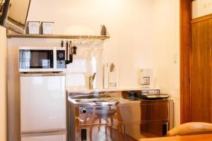 A kitchen or kitchenette at Kiyomizu Shukuba