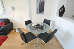 A seating area at Neutral Bay Self-Contained Modern One-Bedroom Apartment (63BEN)