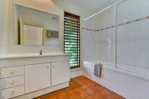 A kitchen or kitchenette at Heliconia Grove 9