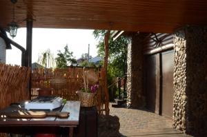 Патио или другая зона на открытом воздухе в Агроусадьба Каменецкое затишье