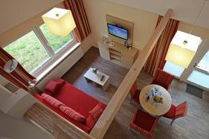 Ein Sitzbereich in der Unterkunft Ferienzentrum Trassenmoor