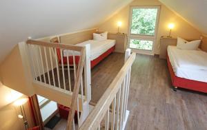 Ein Bett oder Betten in einem Zimmer der Unterkunft Ferienzentrum Trassenmoor