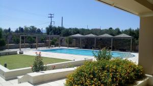 The swimming pool at or close to Villa Metaxas