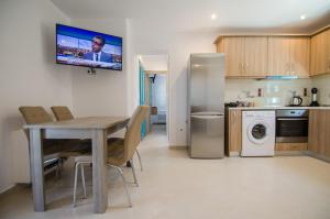 A kitchen or kitchenette at Ios Sea View