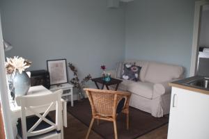 A seating area at Apartment Fleur de Lys Bleue