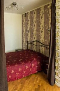 Кровать или кровати в номере Apartment on Leninskaya