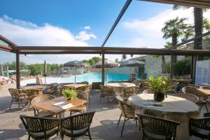 A restaurant or other place to eat at Le Ali Del Frassino