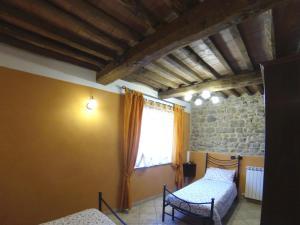 เตียงในห้องที่ Agriturismo il Tiglio