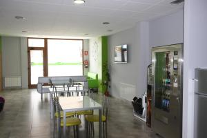 A restaurant or other place to eat at Albergue Outeiro