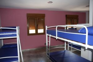 A bunk bed or bunk beds in a room at Albergue Outeiro