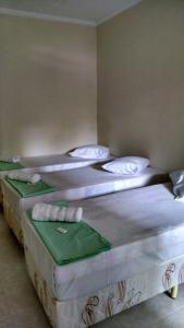 Cama ou camas em um quarto em Hotel Pousada do Papa