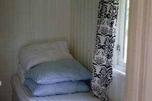 A bed or beds in a room at Volsdalen Camping
