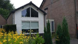 Een patio of ander buitengedeelte van Vino Grando Cottage