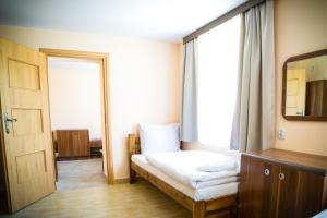 Łóżko lub łóżka w pokoju w obiekcie Kompleks Hotelarski Zgoda