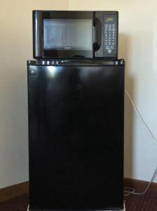 A television and/or entertainment center at Greenway Motel