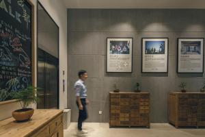The lobby or reception area at Travelling With Hotel Chengdu Wide and Narrow Alley