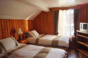 Cama o camas de una habitación en Hosteria el Arroyo
