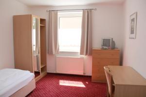 Um quarto em Snooze Guesthouse