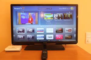 Телевизор и/или развлекательный центр в Apartment on Lenina