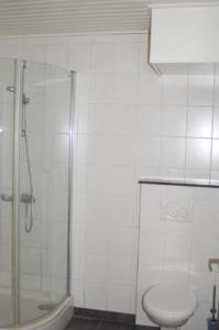 Een badkamer bij Vino Grando Cottage