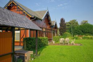 Een patio of ander buitengedeelte van Halte Sint-Gerlach Holiday Home