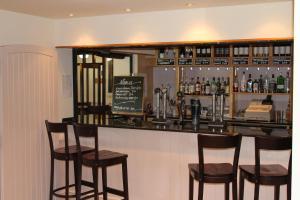 The lounge or bar area at Oak Farm Hotel