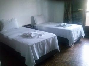 A bed or beds in a room at Ouro Preto Hotel